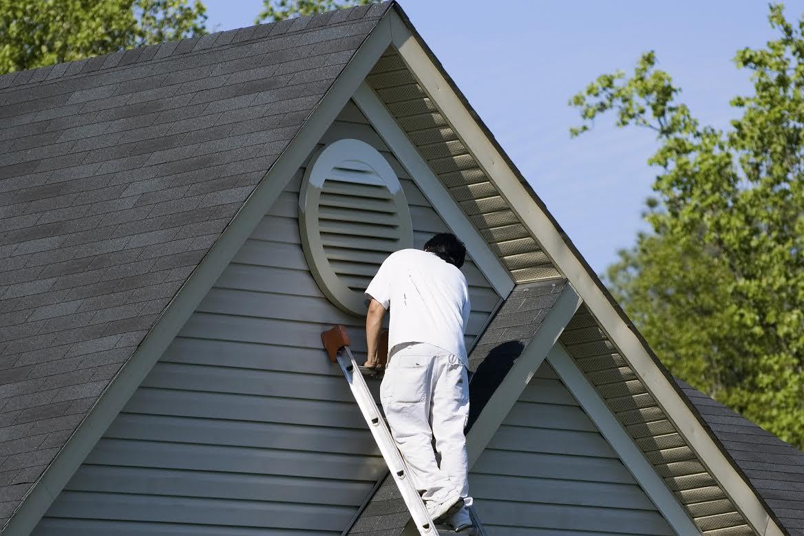 painter painting attic window