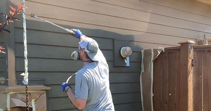 painter-spray-painting-house-exterior