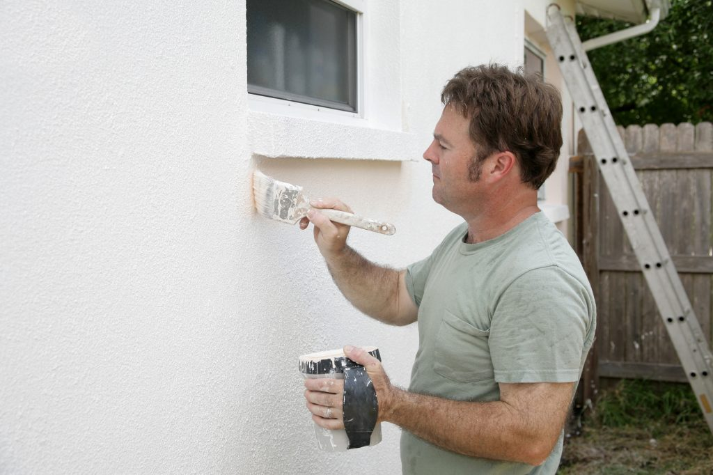 painter-touching-up-house-paint-exterior